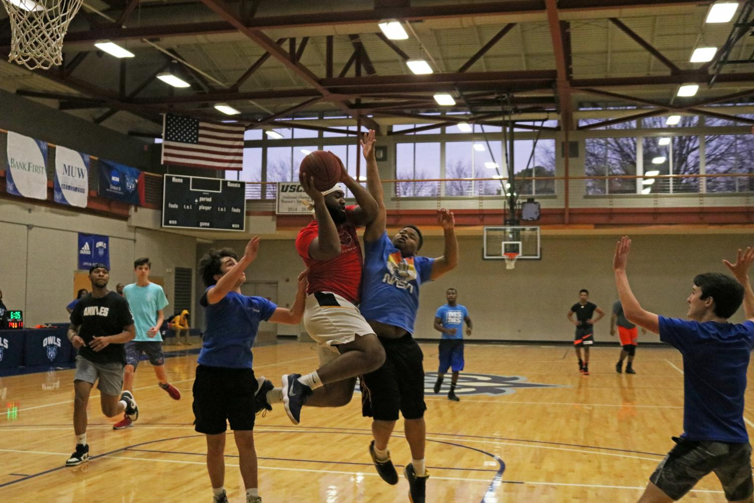 The students vs. faculty basketball game ended with the staff winning 45-35.