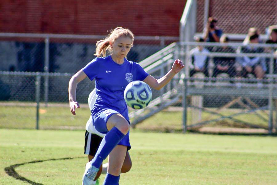 Soccer Co-Captain Taylor Willis makes a wave
