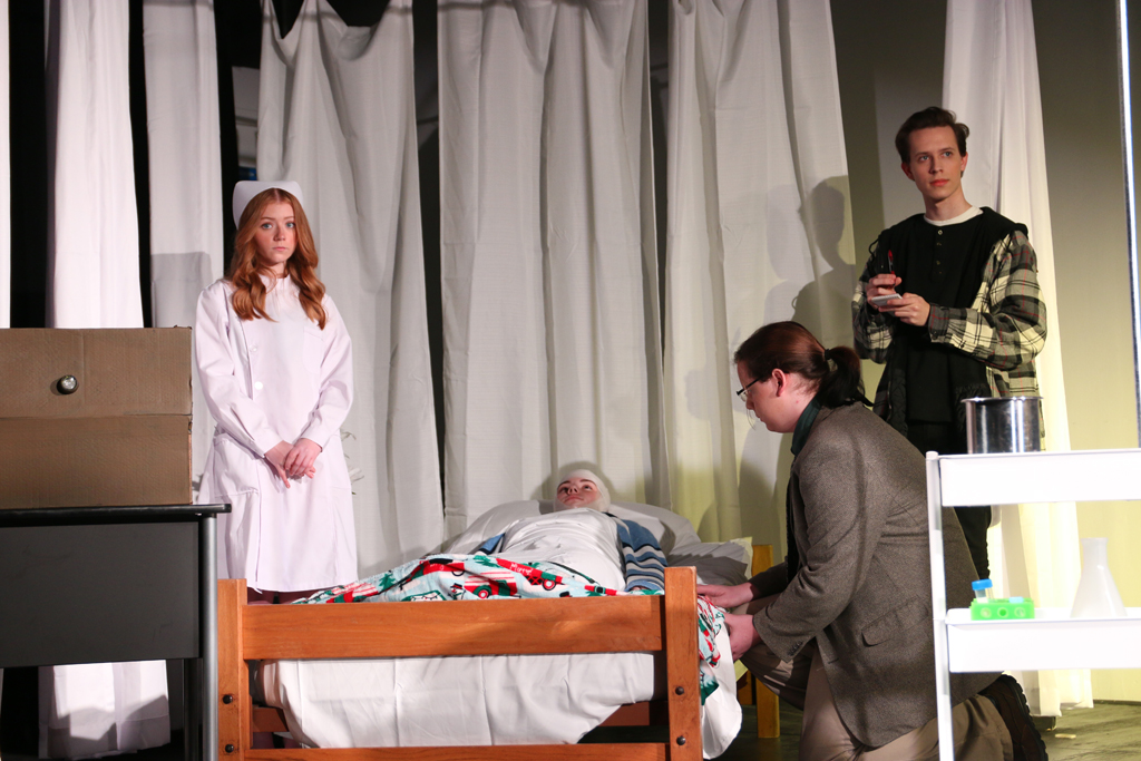 Seniors (from left to right) Taylor Willis, Samantha Holland, Garrett Wells and Davan Reece portray their characters in Dramatic Performance's rendition of Agatha Christie's
