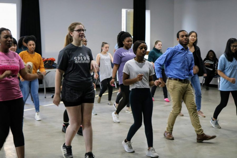 Students followed Johnson's lead in learning several salsa moves.