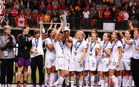 The USWNT celebrates after their first place finish in the 2012 Olympic Qualifiers.