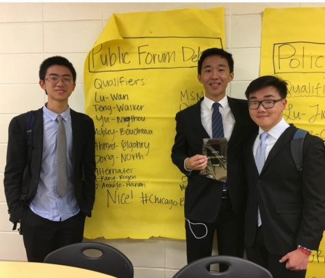 Michael Lu (second from right) and Aaron Wan (far right) were both recognized as Academic All-Americans by the National Speech and Debate Association.