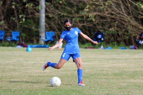 Junior Kareena Patel sets up a shot on the goal.
