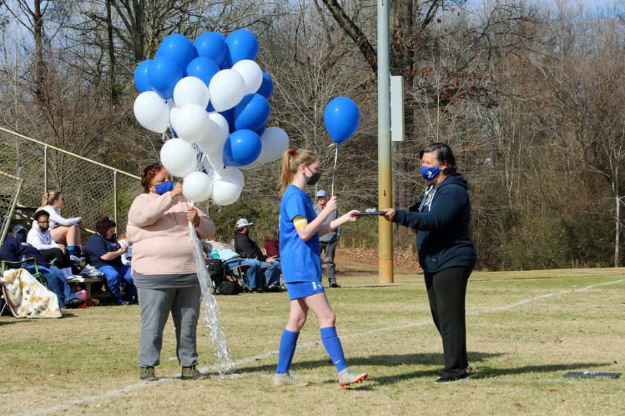 Senior and Co-Captain Ashley Mangus (center) receives recognition for her time on MSMS's soccer team.