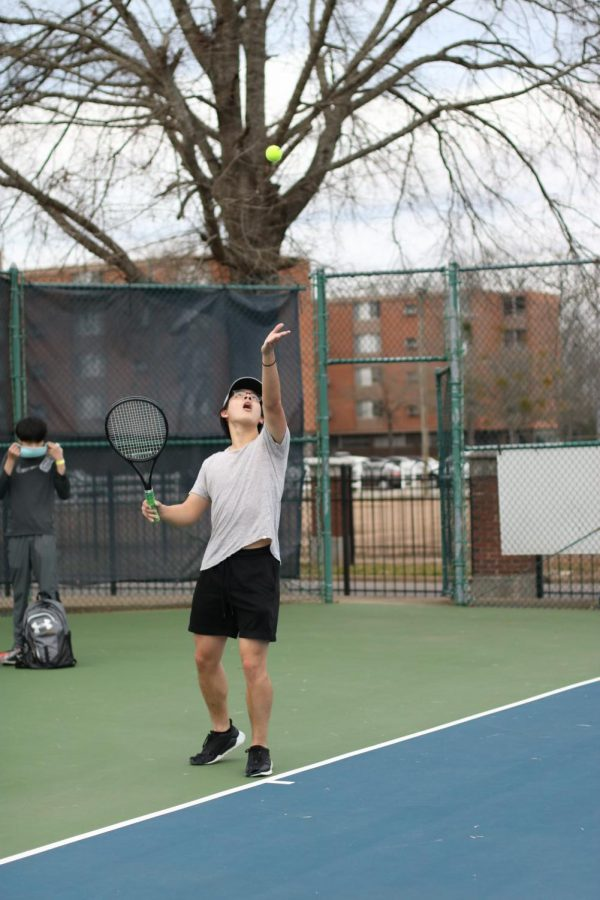 Senior Jesse Tran serves a ball to the opposing player.
