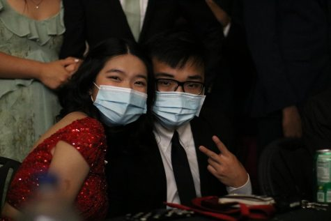 "Seniors Skylar Nguyen and Aaron Wan at the prom, themed ""Enchanted Night."""