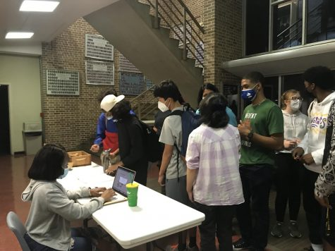 Students wait to enter their names for a chance at winning the Weekly Wednesday Door Prize.