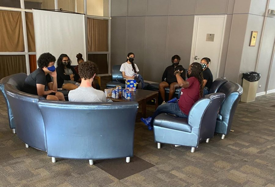 MSMS+students+talk+with+Ms.+LaToya+Bledsoe+as+they+enjoy+an+early+morning+treat.