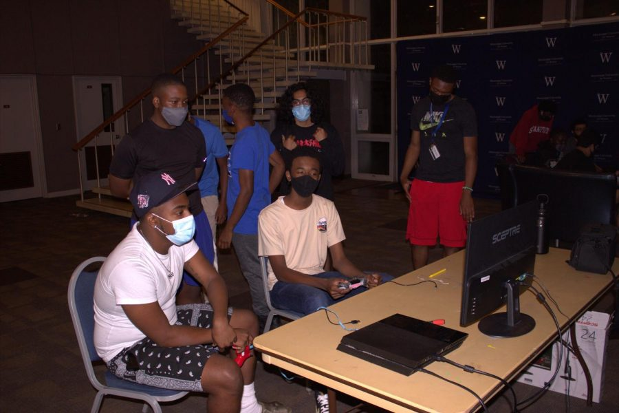 Students enjoy a game night hosted by the Blu Knightz.